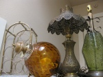 Vintage wine rack $10, Orange swag lamp $25, from India brass ornate lamp $ 35, Green lamp $20